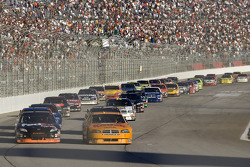 Denny Hamlin and Ryan Newman lead the field thru the tri-oval