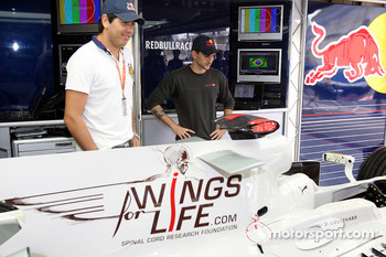 Stock Car drivers Carlos Bueno and Daniel Serra in the Red Bull Racing garage