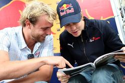 Christoph Rietner and Sebastian Vettel with the Red Bulletin
