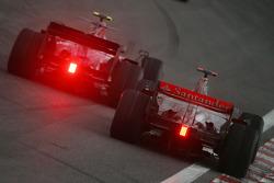 Sebastian Vettel, Scuderia Toro Rosso, STR03 overtakes Lewis Hamilton, McLaren Mercedes, MP4-23