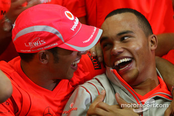 2008 World Champion Lewis Hamilton celebrates with his brother Nicolas