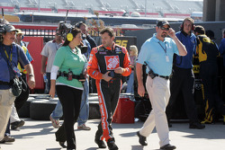 Tony Stewart returns to the garage area after his accident