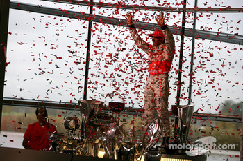 Lewis Hamilton celebrates with McLaren employees