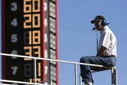 A crew member watches practice action
