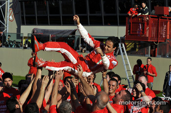 Felipe Massa celebrates with Scuderia Ferrari team members