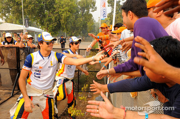 Nelson A. Piquet and Lucas Di Grassi with fans