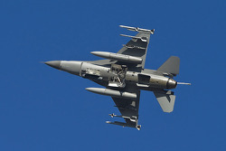 An Air Force F-16 Fighting Falcon performs a flyover