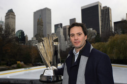 Jimmie Johnson poses with the NASCAR Sprint Cup Series trophy in Central Park above Wollman Rink