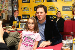 NASCAR Sprint Cup Series champion Jimmie Johnson takes a picture with a young fan at Foley's