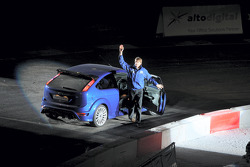 Marcus Gronholm acknowledges the crowd at Cardiff's Millenium Stadium after the World Driving debut of the new Ford Focus RS
