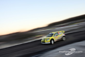 Toni Gardemeister and Tomi Tuominen, Suzuki World Rally Team, Suzuki SX4