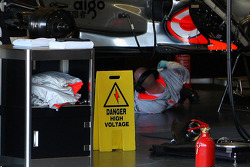 McLaren Mercedes, work on a car with KERS in the garage