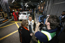 Michael Schumacher gives an interview in the pit lane