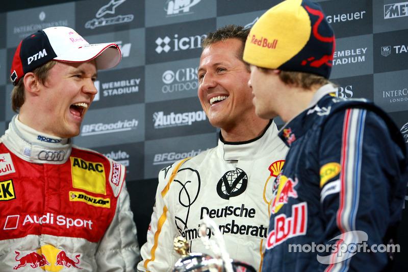 Podium: Nations Cup winners Michael Schumacher and Sebastian Vettel (Team Germany) celebrate with second place Mattias Ekström (Team Scandinavia)