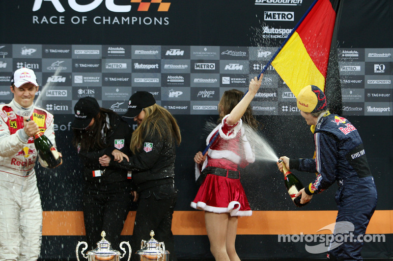 Podium: Sebastian Vettel and Mattias Ekström spray champagne