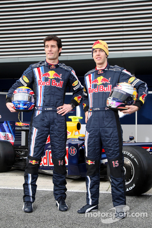 Sebastian Vettel and Mark Webber pose with the new Red Bull RB5