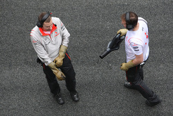 McLaren Mercedes mechanics wear gloves to protect from KERS