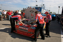 Stewart-Haas Racing Chevrolet crew members look at the wrecked car of Tony Stewart after his crash with teammate Ryan Newman, Stewart-Haas Racing Chevrolet