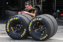 Crewman checks tire wear
