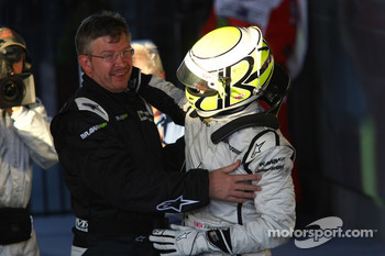Jenson Button, Brawn GP, celebrates with Ross Brawn Brawn Grand Prix Team Principal