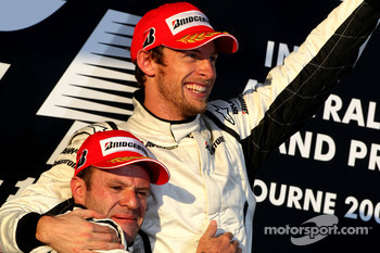 Podium: race winner Jenson Button, Brawn GP, second place Rubens Barrichello
