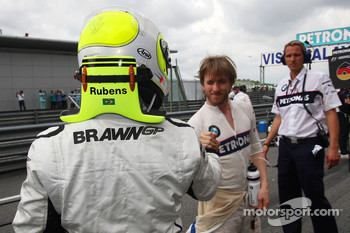 Rubens Barrichello, Brawn GP and Nick Heidfeld, BMW Sauber F1 Team