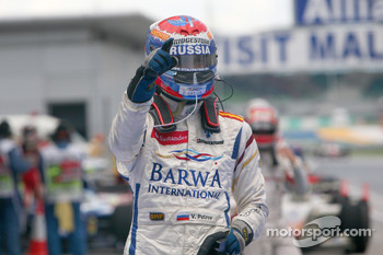 Vitaly Petrov celebrates his victory