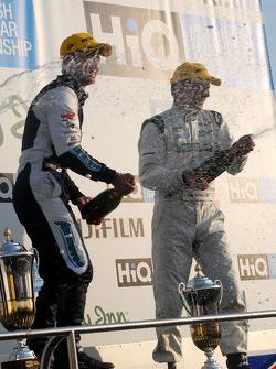 Adam and Plato spray the champagne