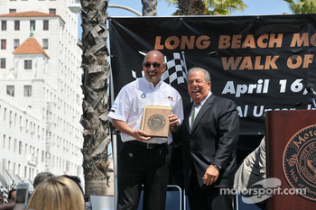 Bobby Rahal receives his plaque from Mayor Bob Foster