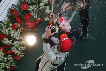 Podium: champagne for race winner Sebastian Vettel, Red Bull Racing, second place Mark Webber, Red Bull Racing