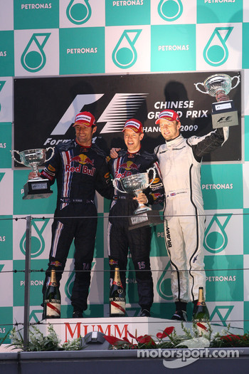Podium: race winner Sebastian Vettel, Red Bull Racing, second place Mark Webber, Red Bull Racing, third place Jenson Button, Brawn GP