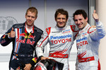 Pole winner Jarno Trulli, Toyota F1 Team with second place Timo Glock, Toyota F1 Team and third place Sebastian Vettel, Red Bull Racing