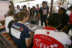 Hamad Al Fardan, Vitaly Petrov, Kamui Kobayashi and Davide Valsecchi sign autographs for the fans