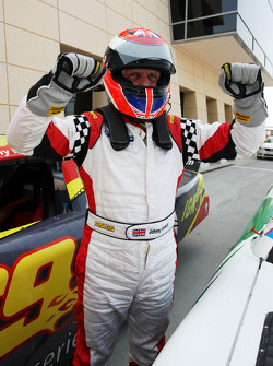 Race winner Johnny Herbert JMB celebrates in parc ferme