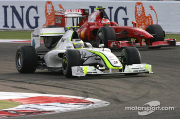 Rubens Barrichello, Brawn GP and Kimi Raikkonen, Scuderia Ferrari