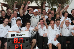 Brawn GP celebration: Jenson Button celebrates win with teammate Rubens Barrichello and Brawn GP team members