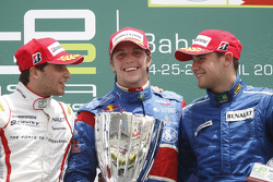 Luiz Razia celebrates his first GP2 Asia victory on the podium with Jerome D'Ambrosio and Davide Rigon