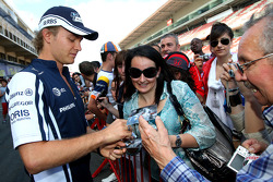 Nico Rosberg, Williams F1 Team signing autographs for the fans