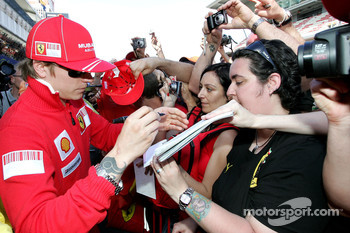 Kimi Raikkonen, Scuderia Ferrari signing autographs for the fans