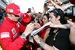 Kimi Raikkonen, Scuderia Ferrari signing autographs for the fans