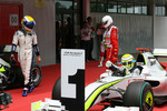Nico Rosberg, Williams F1 Team looks at pole winner Jenson Button, Brawn GP
