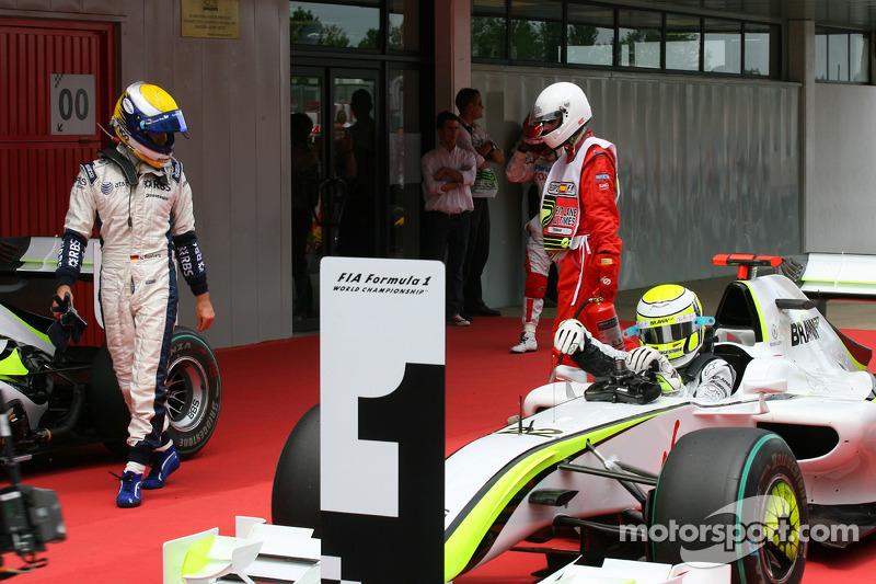Nico Rosberg, Williams F1 Team looks at pole winner Jenson Button, Brawn GP