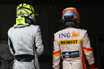 Pole winner Jenson Button, Brawn GP and Fernando Alonso, Renault F1 Team