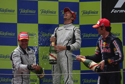 Podium: race winner Jenson Button, Brawn GP, second place Rubens Barrichello, Brawn GP, third place Mark Webber, Red Bull Racing