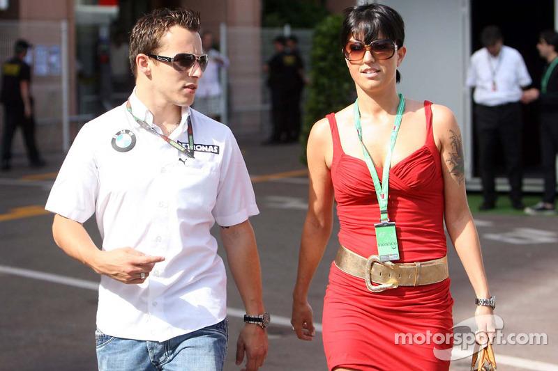 Christian Klien, Test Driver, BMW Sauber F1 Team walking with an girl