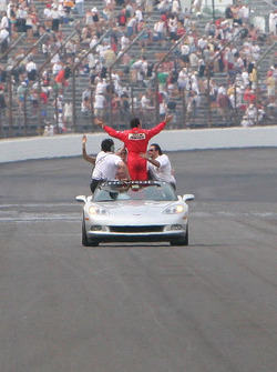 Helio Castroneves gets a victory lap in a Corvette