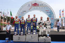 Podium: race winners Jari-Matta Latvala and Miikka Anttila, second place Mikko Hirvonen and Jarmo Lehtinen, third place Petter Solberg and Phil Mills