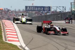 Lewis Hamilton, McLaren Mercedes leads Rubens Barrichello, Brawn GP