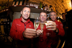 Hand imprint ceremony: 2008 winners Tom Kristensen, Allan McNish and Rinaldo Capello toast with champagne at the reception