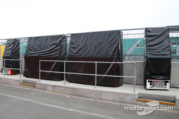 Ferrari's covered up pitwall gantry